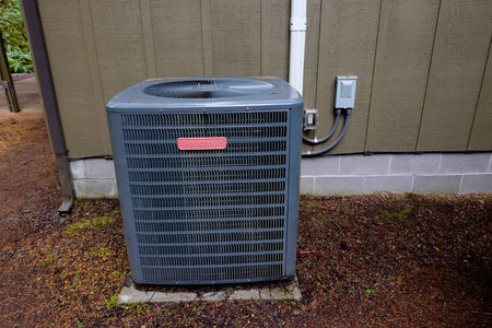 MCKENZIE BRIDGE, OR - MARCH 4, 2016: Goodman HVAC unit on the outside of a vacation house.