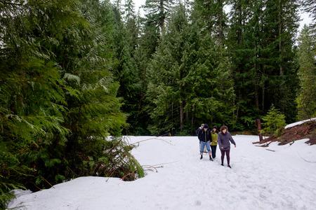 oregon  snow: MCKENZIE BRIDGE, OR - MARCH 5, 2016: Family snow hike to Koosah Falls on the McKenzie River in Oregon.