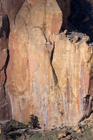 smith rock: SMITH ROCK, OR - FEBRUARY 22, 2016: Rock climber works his way up a popular climbing pitch at Smith Rock State Park in Central Oregon.