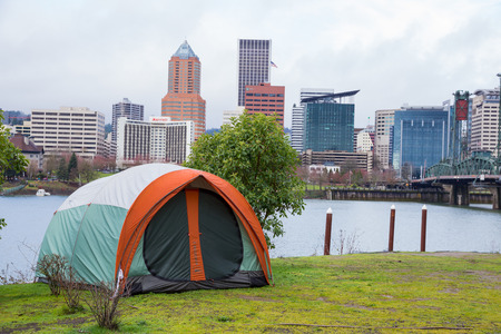 trespass: PORTLAND, OR - FEBRUARY 27, 2016: Tent in a riverfront park across the Willamette River from downtown Portland Oregon. Homelessness in the Lloyd District has reached an all-time high.