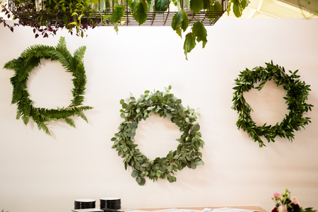 decorations wreaths: Wreaths used for decor by a florist at a wedding reception in Oregon. Stock Photo
