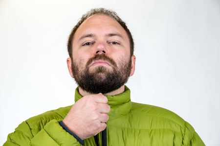 average guy: Man in his mid-30s poses for a studio portrait with a semi white background.