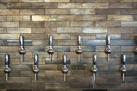 Taphouse in Portland Oregon with multiple tap handles for craft beer and wine.