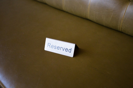 reserved seat: Reserved seats at a wedding ceremony and reception shown with this metal tag.
