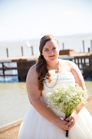 club dress: Portrait of a bride in her wedding dress outdoors in Oregon at a yacht club marina. Stock Photo