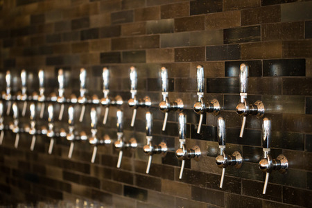 taphouse: Taphouse in Portland Oregon with multiple tap handles for craft beer and wine.