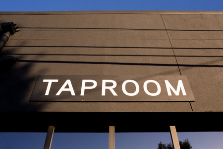 Taproom sign at a popular taphouse serving craft beer and growler fills.