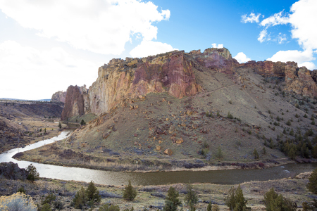 smith rock: Smith Rock State Park and the Crooked River during the daytime in the Winter. This is a great time to do some rock climbing as the sun doesnt make the rocks too hot to hold onto.