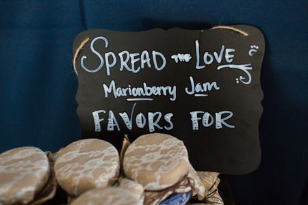 wedding favors: Wedding favors at this Oregon wedding include homemade marionberry jam in canning jars.