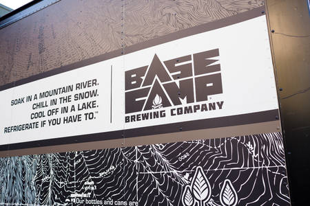 taphouse: PORTLAND, OR - OCTOBER 24, 2015: Sign for Basecamp Brewing Company, a craft brewery in Portland Oregon.