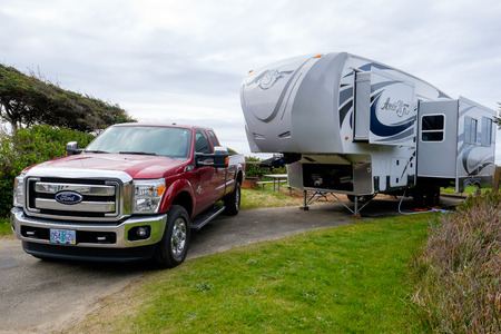YACHATS, OR - MARCH 19, 2016: Campsite with a large Arctic Fox 5th Wheel and a Ford F350 truck.