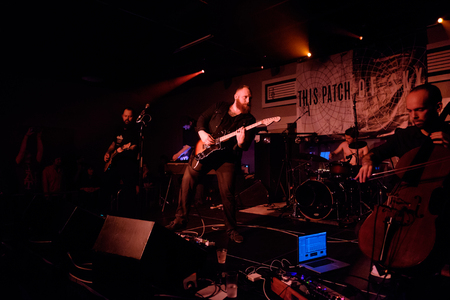 march band: EUGENE, OR - MARCH 26, 2016: Post-rock instrumental band This Patch of Sky performs at the HiFi Music Hall in Eugene, Oregin, USA. The bands talented musicianship and lack of vocals have set them apart, gaining international popularity.