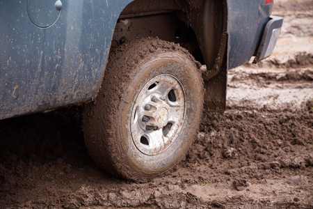 messed up: KLAMATH FALLS, OR - MARCH 8, 2016: Chevrolet truck parked on a very muddy road with tires directly in the mud on a country property.
