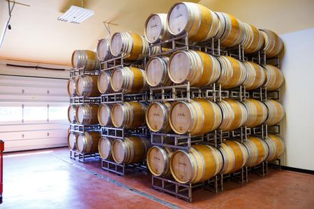 willamette: EUGENE, OR - MAY 2, 2015: Barrel room detail of large wine barrels stacked together at Sweet Cheeks winery in Eugene Oregon.