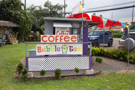 KAHUKU, OAHU, HAWAII - FEBRUARY 27, 2017: Coffee stand and bubble tea cart at the foodtruck property near the shrimp farms and country town of Kahuku on the North Shore of Oahu Hawaii.