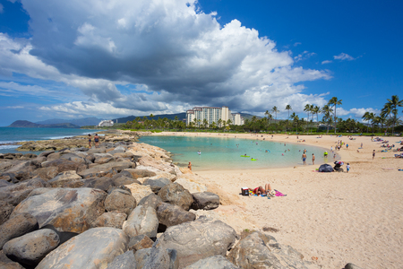 oahu: KOOLINA, OAHU, HAWAII - FEBRUARY 26, 2017: Busy weekend day for the lagoons at Koolina. This protected lagoon was mandmade by the local hotels and resorts in Koolina Oahu Hawaii.