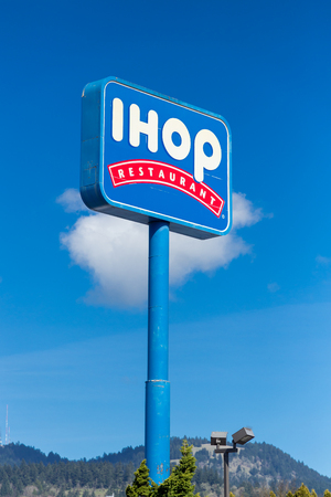 SPRINGFIELD, OR - MARCH 31, 2017: IHOP Restaurant sign with a blue sky in Springfield Oregon. Editorial