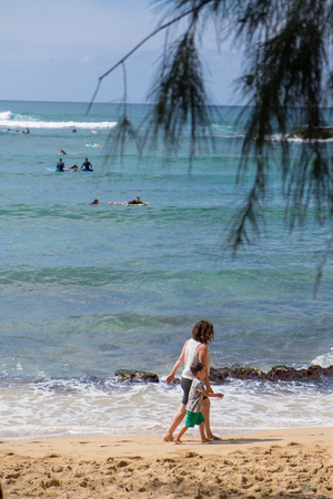HALEIWA, OAHU, HAWAII - FEBRUARY 23, 2017: Very busy day with many surfers and surf schools in the water catching waves in Haleiwa Oahu Hawaii.