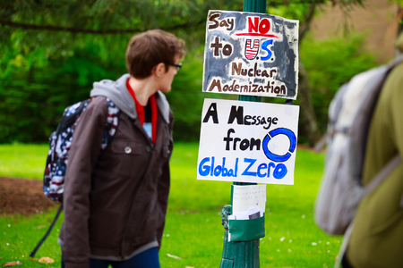 EUGENE, OR - MAY 9, 2015: Protest sign says no to U.S. nuclear modernization, a message from Global Zero group on the University of Oregon campus in Eugene.