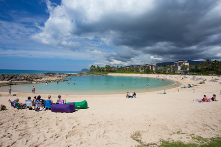KOOLINA, OAHU, HAWAII - FEBRUARY 26, 2017: Busy weekend day for the lagoons at Koolina. This protected lagoon was mandmade by the local hotels and resorts in Koolina Oahu Hawaii.