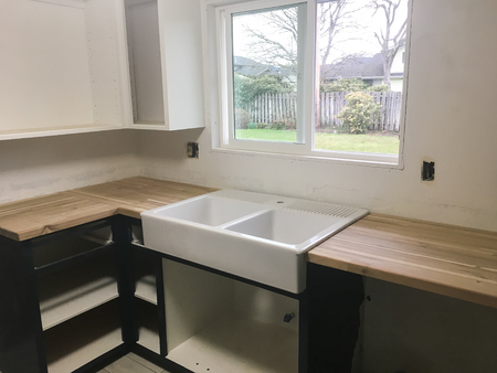 junked: Large farmhouse sink in the kitchen of a full renovation and house remodel.