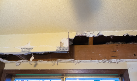 Major mess from a soffit demo during a home renovation and remodel in a residential house.