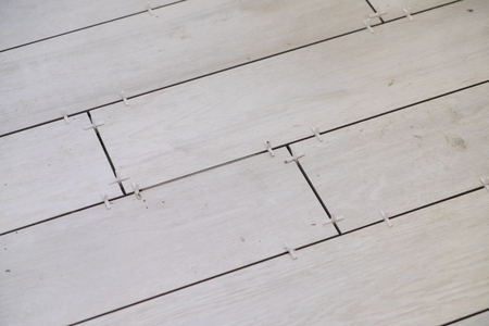 Major house renovation and remodel with white wood grain 6x24 tiles set in the kitchen.