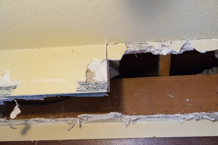 trashed: Major mess from a soffit demo during a home renovation and remodel in a residential house.