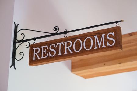 venue: Restrooms Sign at Wedding Venue