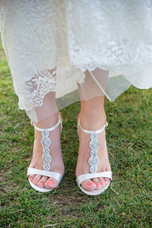 stilleto: Bride Wedding Shoes on Grass Stock Photo