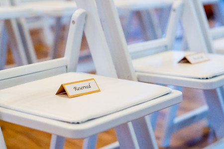 Reserved Sign on Chairs at Wedding