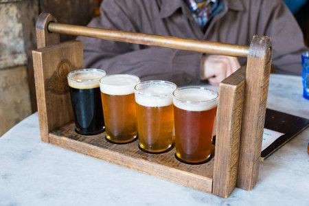 Craft Beer Sampler Four Glasses Reklamní fotografie