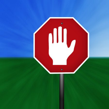A stop sign with warning hand illustration with a grass and sky background. Banco de Imagens