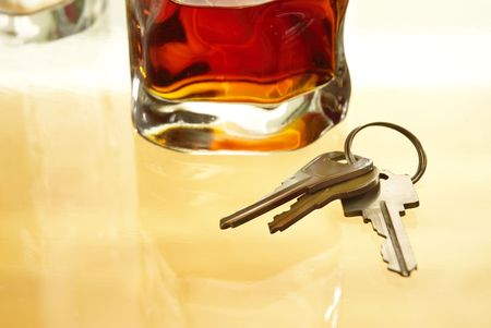 Glass of alcohol and key house Stock Photo - 10971772