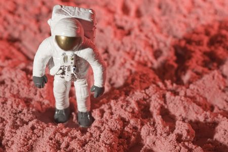This is a picture of one astronaut figurine walking and discovering a planet.