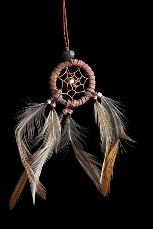 This is a small dream catcher over a blackbackground.