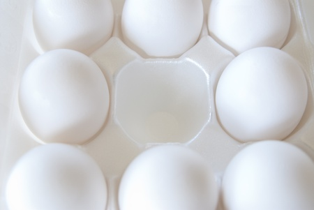 This is a white eggs crete with white eggs in it but one is missing.