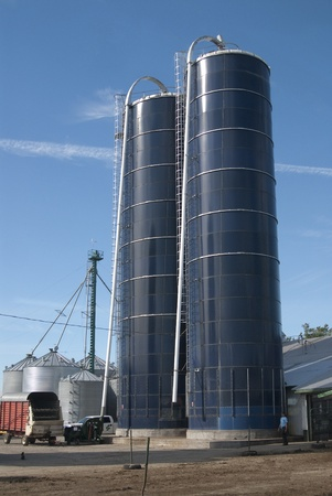 This two blue silos that contain cow food. Stock Photo - 11293801