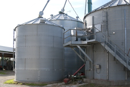 This is some steel gray silo in a farmland. Stock Photo - 11293824