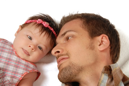 This is a close-up of a baby girl and her father on a white background  photo