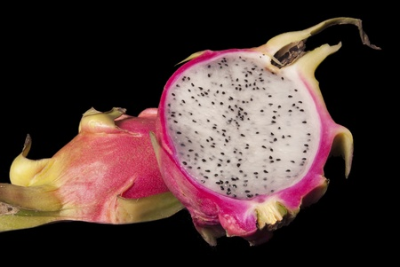 This is the inside of a dragon fruit over a black background. Stock fotó