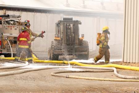 It is three firefighters work hard for our security.