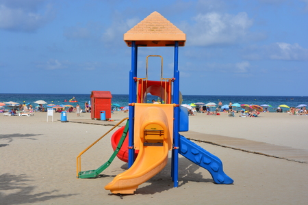 Colourful slides and play area, Arenal beach on the Costa Blanca in the summer, Javea, Alicante Province, Spain