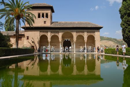 Visitors at the open portico of Torre de las Damas, Tower of The Ladies, Partal, The Alhambra, Granada, Andalusia, Spain Editorial
