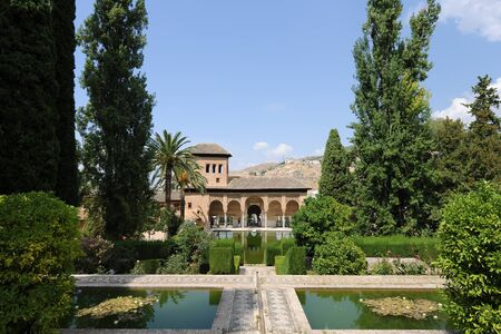 View across the Partal gardens and water features  to  the Torre de las Damas, Tower of The Ladies, The Alhambra Palaces, Granada, Andalusia, Spain