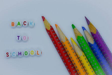 Back to School, alphabet beads  color pencils on a plain white background. Banco de Imagens
