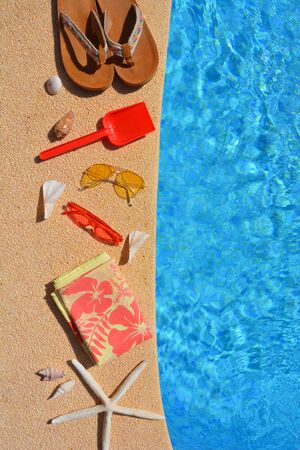 Summer holiday flat lay. Yellow sunglasses, red sunglasses, red spade, starfish, and seashells on the poolside. High angle view with copy space, Banco de Imagens