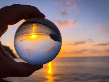 Looking through a crystal ball to beautiful sunrise over sea. with copy space. Creative refraction photography. Cabo San Antonio, Cape San Antonio, Javea, Alicante Province, Spain