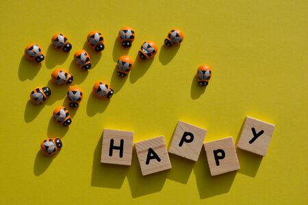 Be Happy, with wooden bees and the word Happy