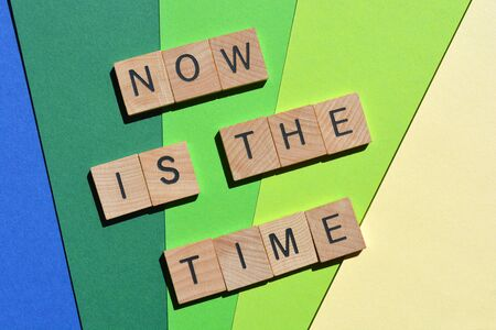 Now is The Time, phrase in wooden letters Stock Photo